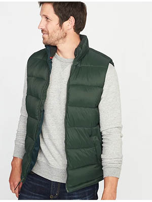 A man in a green vest
