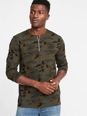 A man in a military henley