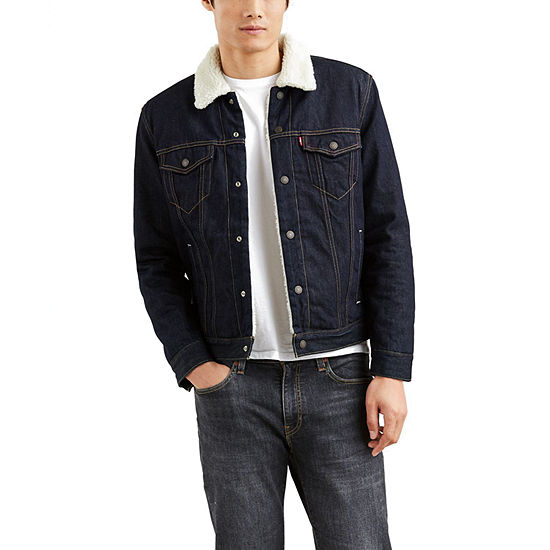 A man wearing a denim jacket with sherpa collar