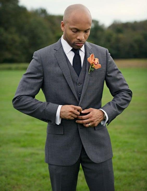 groom in three piece suit