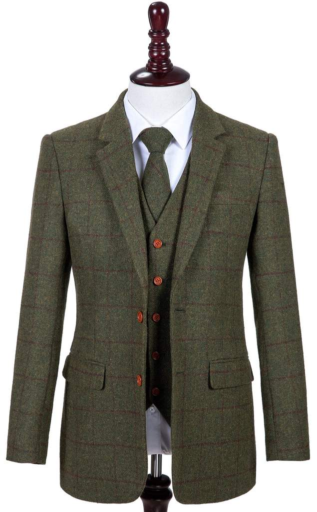 A man wearing a green tweed suit and tie