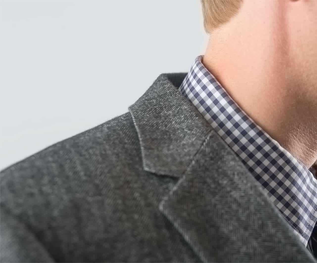 Close up showing collar gap between suit and shirt collar