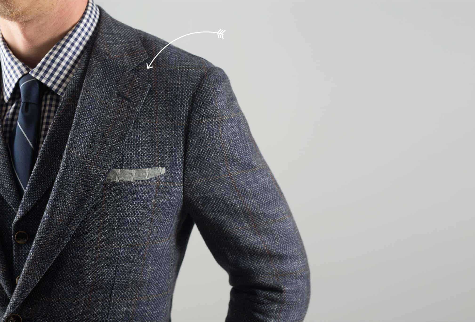 Arrow pointing at suit collar