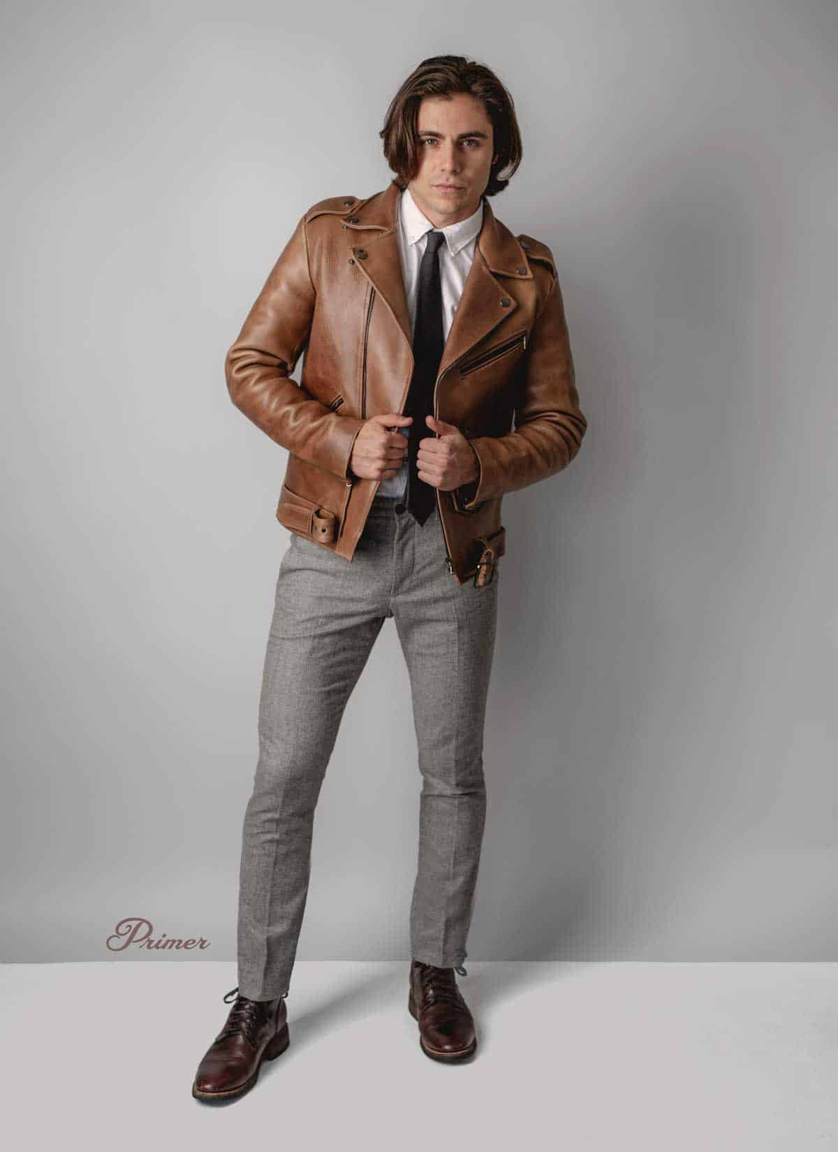brown leather jacket with tie and gray dress pants