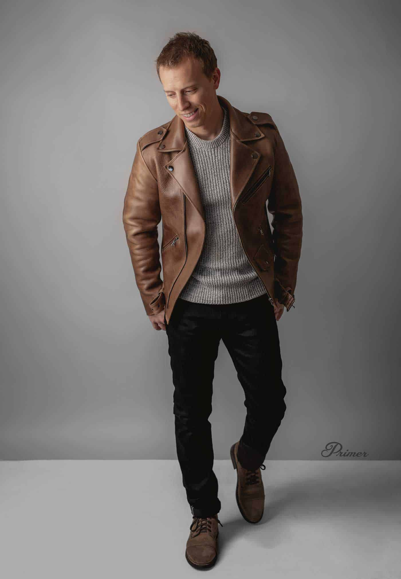 brown leather jacket men outfit inspiration gray sweater black jeans