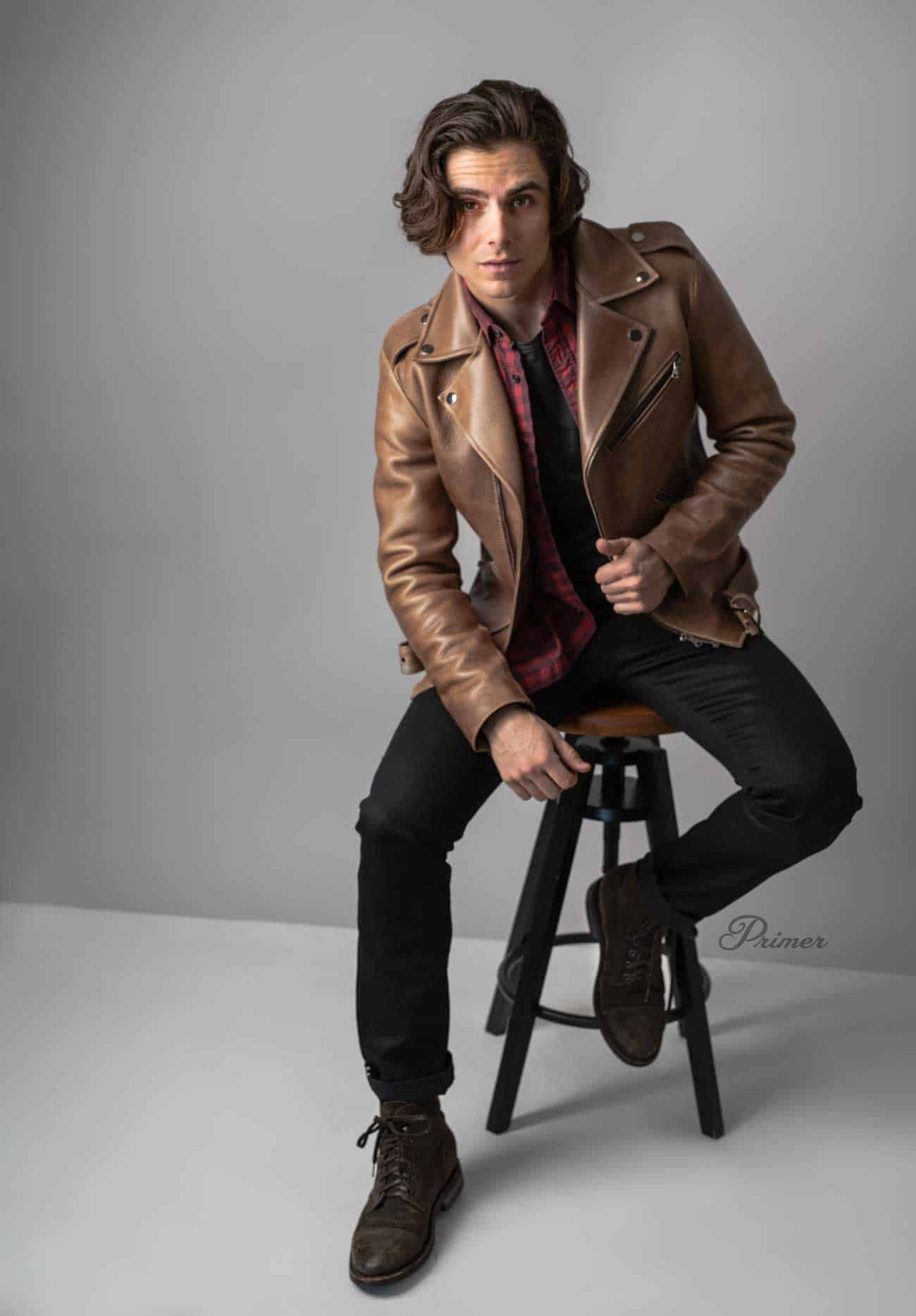 brown leather jacket with black jeans