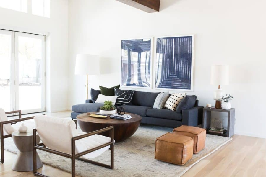 Image of white living room space with navy furniture