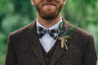 A man wearing a suit and bow tie