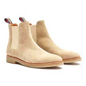 A close up of a suede chelsea boots