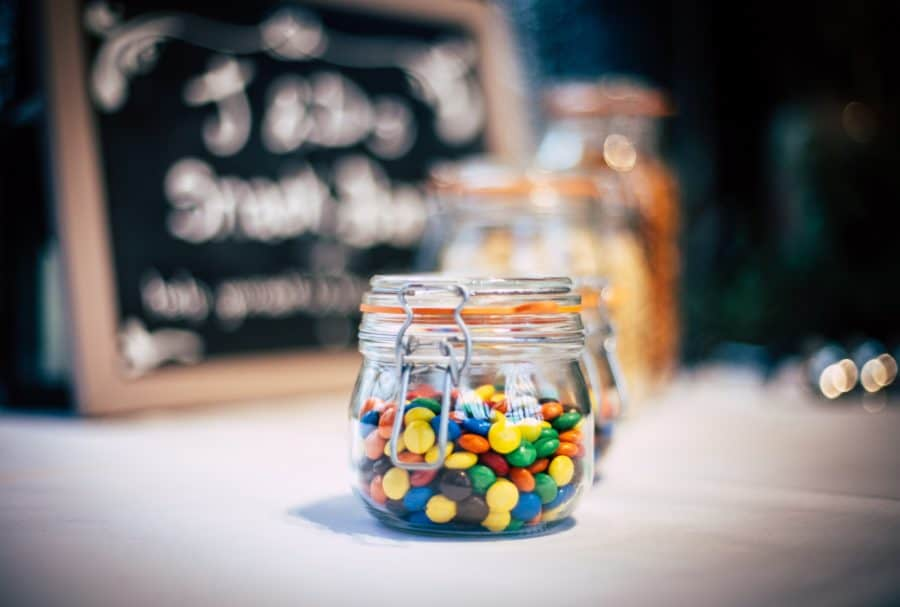 Image of sweet, jar, sign and table top HD photo by Clem Onojeghuo