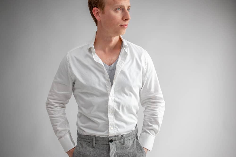 gray undershirt under white dress shirt