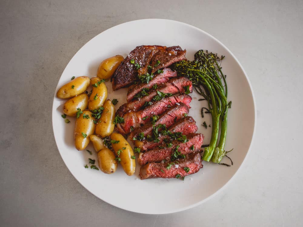 sliced steak potatoes broccolini