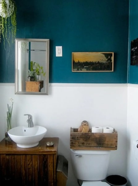 Image of bathroom with turquoise wall from apartment therapy