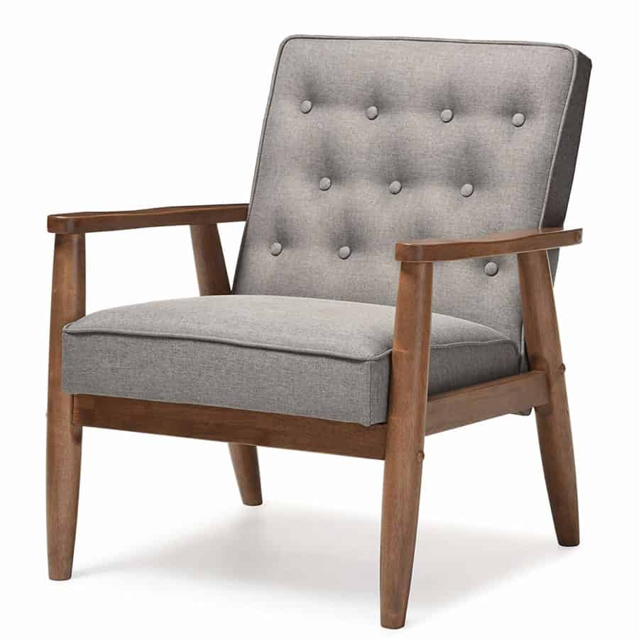 A gray chair with wood accents