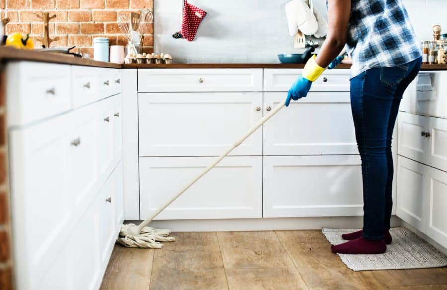 Image of person mopping the floor of a kitchen