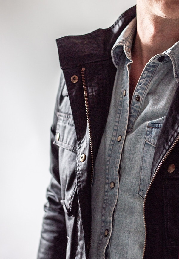 close up light denim shirt gray jacket