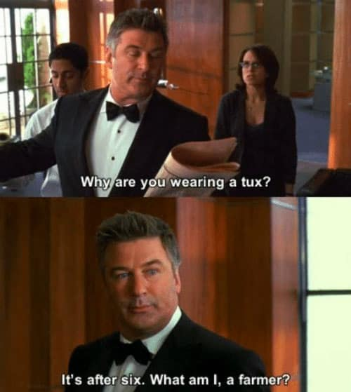 Alec Baldwin wearing a tux posing for a picture