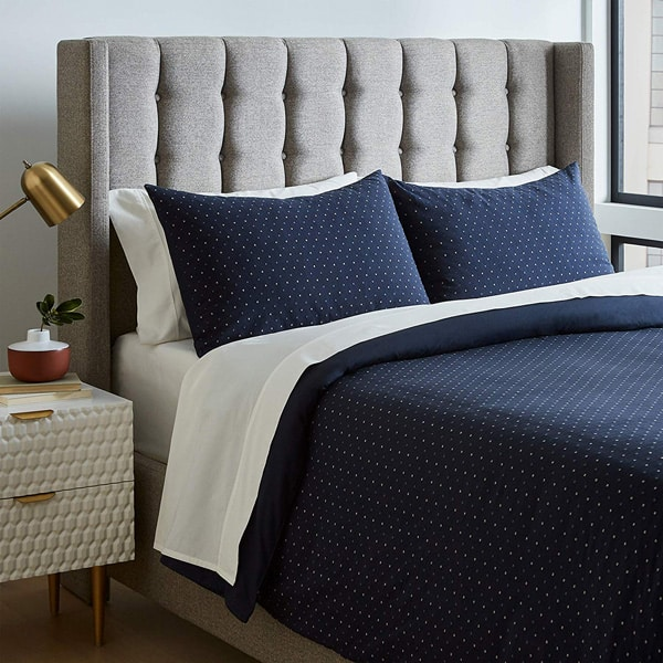 blue geometric duvet guy bedroom