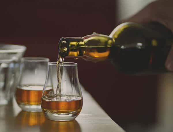 pouring scotch into a dram