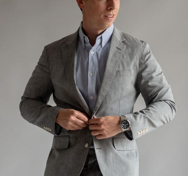 blue and white stripe short sleeve shirt with gray suit
