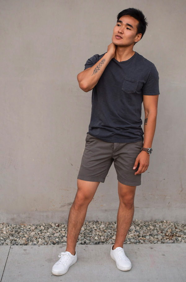 black pocket t shirt gray shorts white sneakers