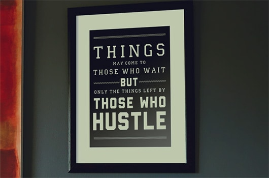 Free hustle quote art print in frame on wall
