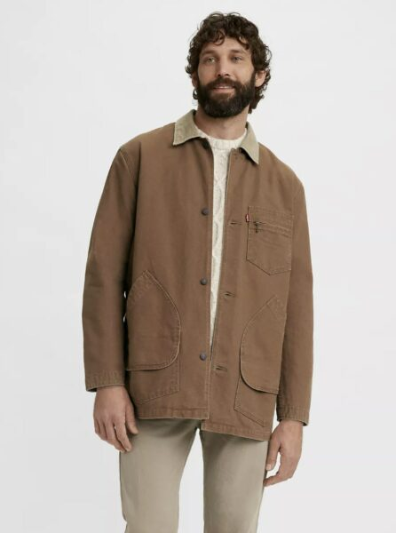 man wearing a brown chore style coat