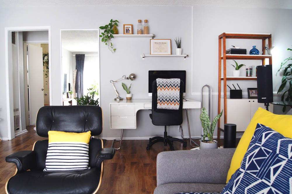 apartment plants eames lounge chair desk