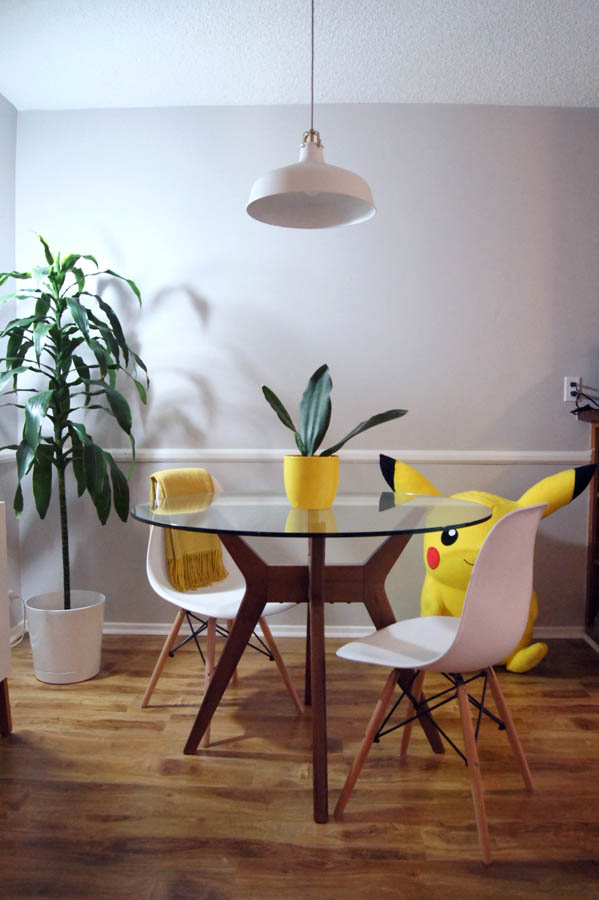 apartment dining room with whale fin snake plant