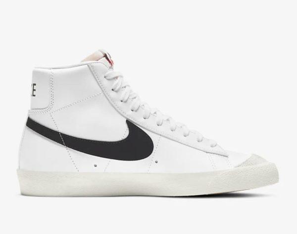 nike mid top white sneaker with black nike brand logo