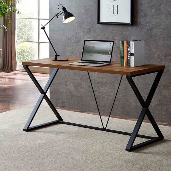 A wood and metal desk in a room