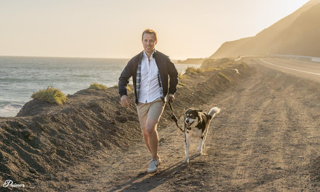 harrington jacket white oxford cloth shirt khaki shorts sneakers summer outfit on beach