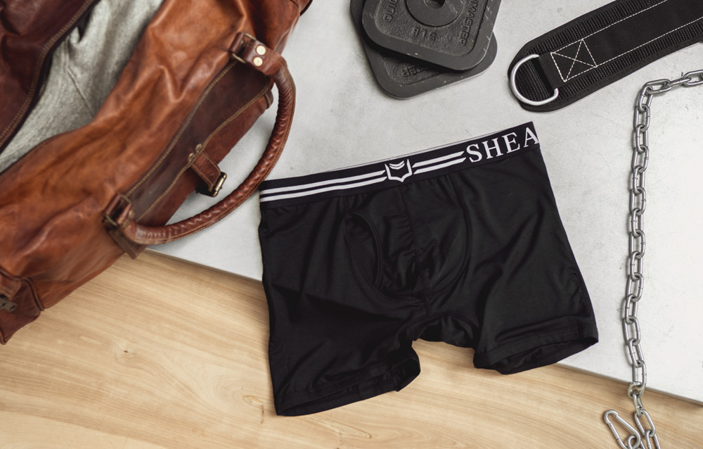 Sheath underwear on table with bag and weights