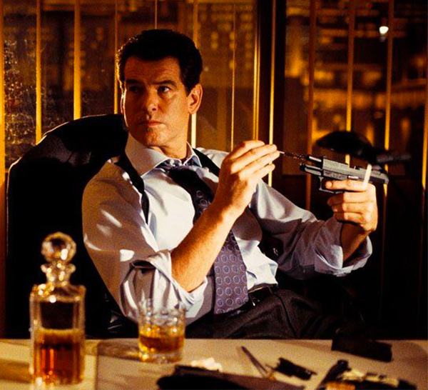 pierce brosnan drinking whiskey as james bond