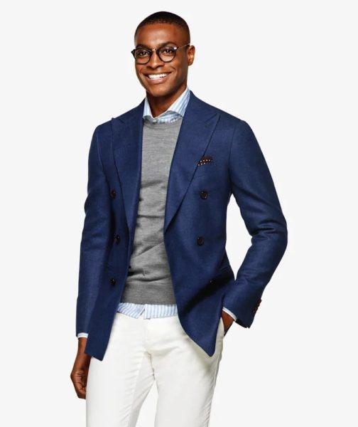 A man wearing a blue suit jacket