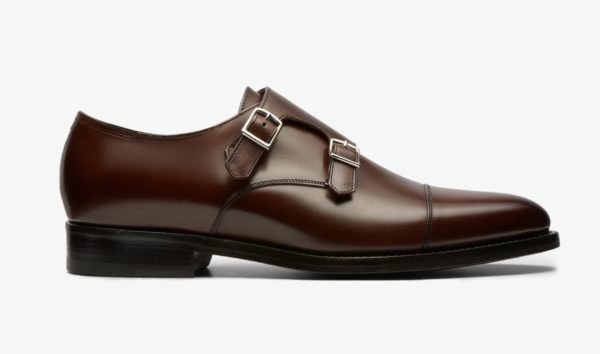 A product image of a dark brown shoe with straps