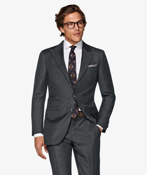 Image of man wearing a dark grey 3 piece suit