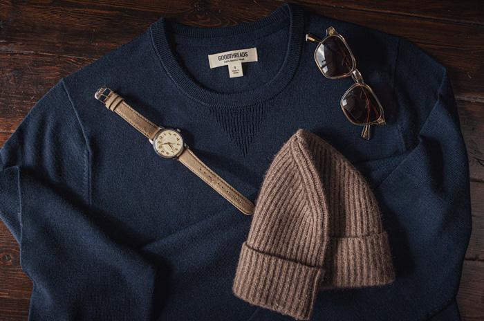 blue merino sweater with watch, beanie, and sunglasses