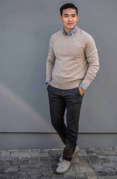 man wearing a v neck sweater and dark pants for primer magazine