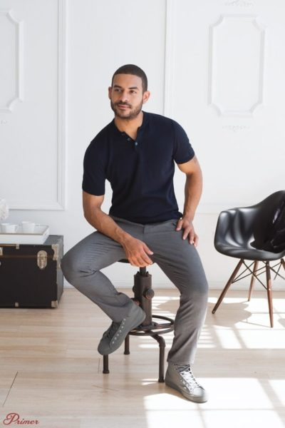 man wearing a short sleeve shirt and grey pants for primer magazine