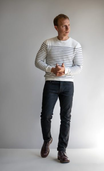 man wearing a striped sweater and dark pants for primer magazine