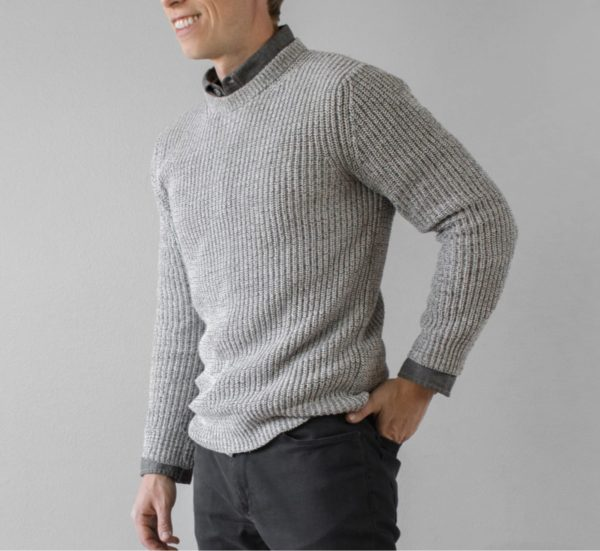 man wearing a grey shaker knit style sweater for primer magazine
