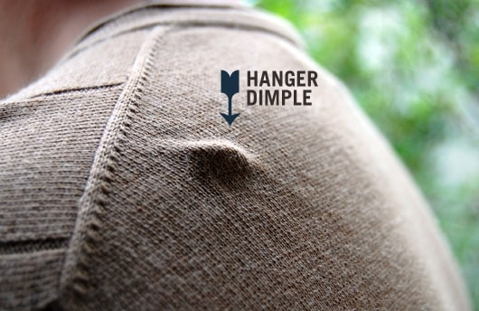 close up of a hanger indent on the shoulder of a sweater