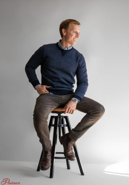 man wearing a merino wool style sweater for primer magazine