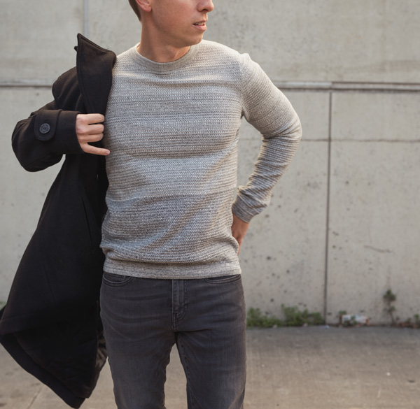 man wearing an ombre cotton style sweater