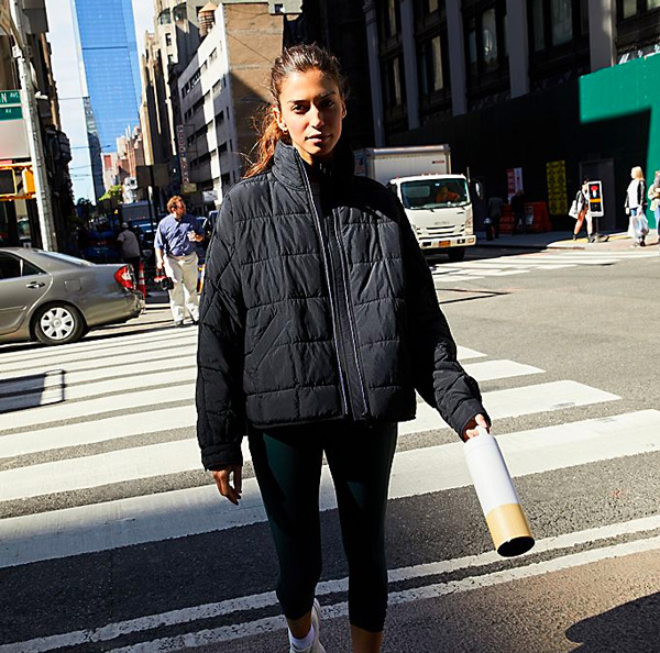 Woman wearing Free People packable jacket