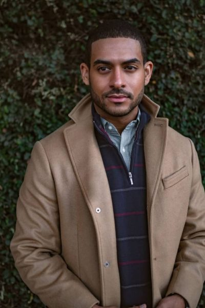 man wearing a winter coat and a half zip sweater for primer magazine