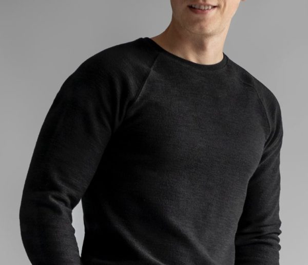 close up of a man wearing a black thermal style sweater for primer magazine