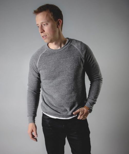 man wearing a grey sweatshirt for primer magazine