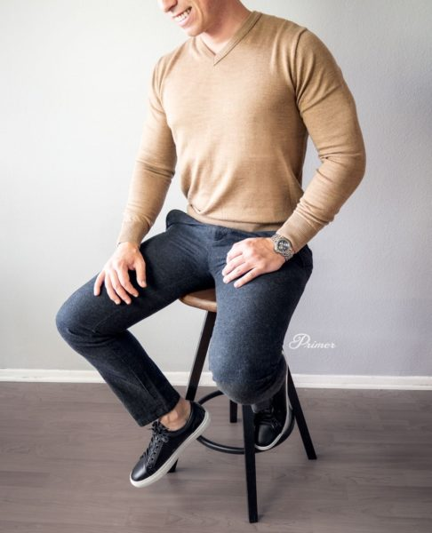 man wearing a v neck sweater for primer magazine